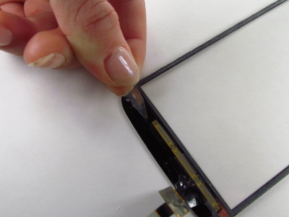 Peel off the excess adhesive from the bezel of the glass screen.