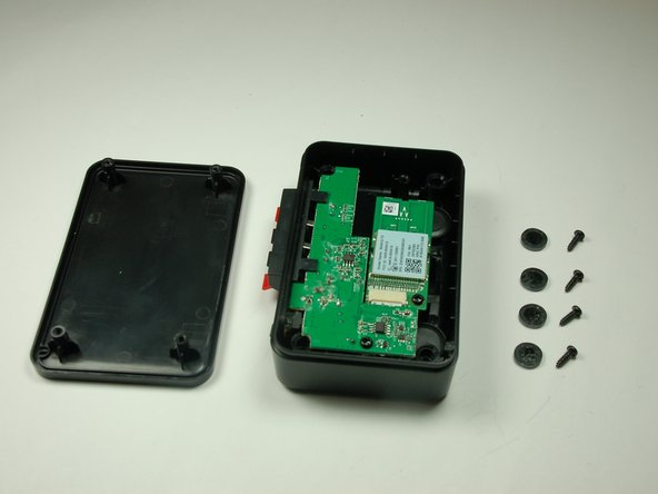 Flip the device over and remove the top casing from the sender.