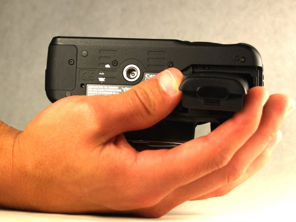 Remove the existing battery with your fingers.