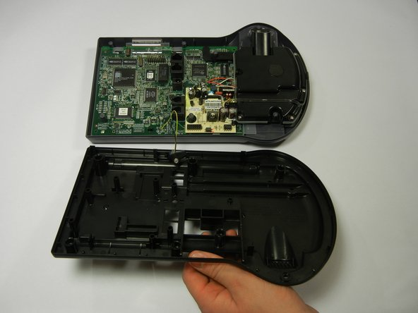Image 2/2: Lifting the back cover should not require a lot of force; simply lift with your fingertips.