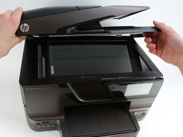 Lift the scanner lid to a resting position.