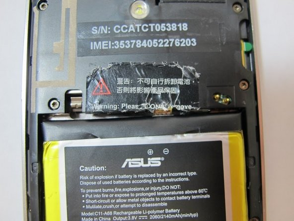 Remove the warning sticker that covers the battery plug and connecting cord.
