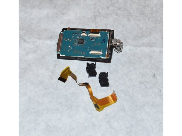 The old flex cable is now free and able to be switched with the new one.
