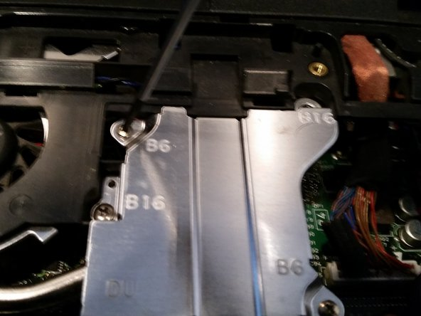 Unscrew all visible screws on the heat sink shield.