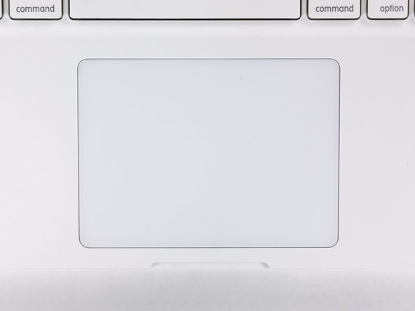 Image 2/2: Flip the upper case over and adjust the position of the trackpad until the gap between the trackpad and the upper case is evenly spaced around the perimeter of the trackpad.