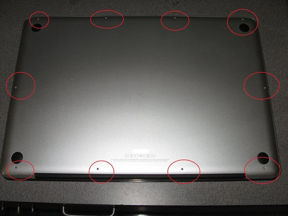 Turn the computer over and remove all of the screws that holds together the bottom of the case.