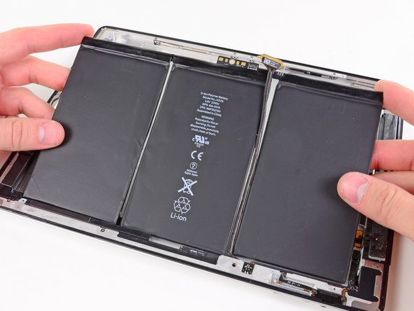 Carefully lift the battery out of the rear panel and remove it from the iPad 2.