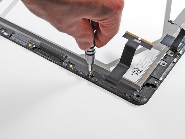 Image 2/3: Each clip holding the display assembly to the rear case is fastened down with its own T4 Torx screw.