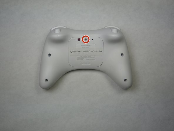 Turn the controller over to reveal the battery cover.