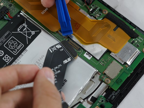 To remove the right speaker, begin by detaching the large black strip connecting from the camera board to the motherboard using a plastic opening tool.