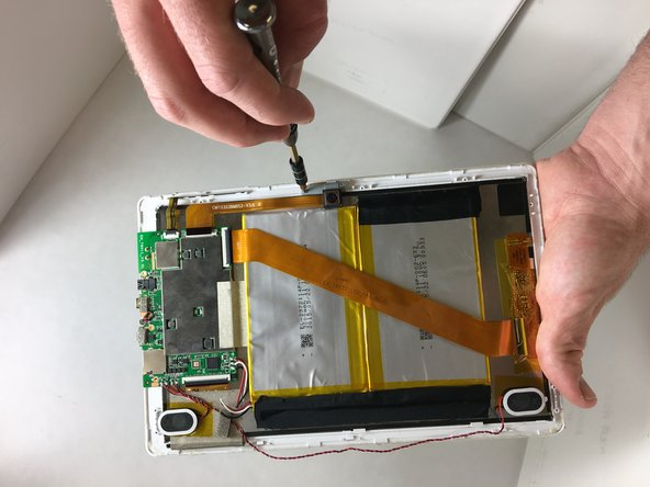 Use a #00 Phillips head screw driver to remove the two screws that hold the camera down to the front case.