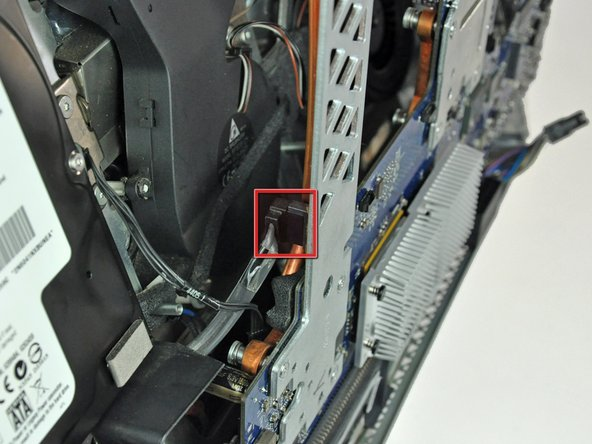 Image 1/2: Insert the blunt end of a metal spudger between the SATA connector and its socket. Twist the shaft of the metal spudger to separate the connector from its socket.