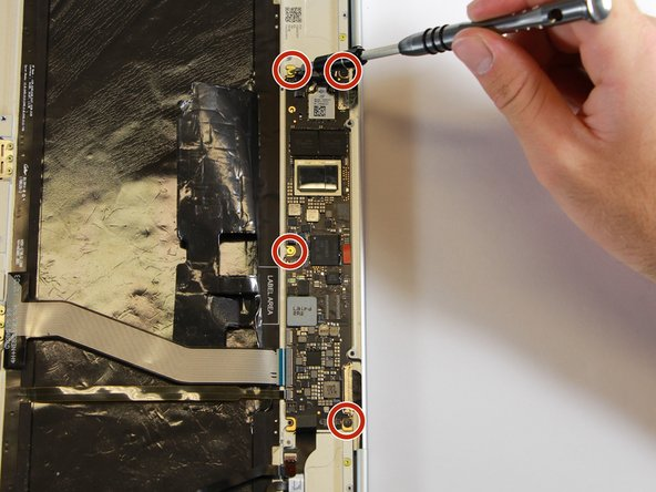 Remove the gold 3.0mm screws and the black, flat 2.0mm screws from the motherboard by using a T3 Torx screwdriver to turn the screws counterclockwise.