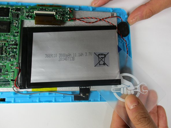 Slide iFixit's Plastic Card tool or a credit card under the battery to remove the glue that is holding it in place.