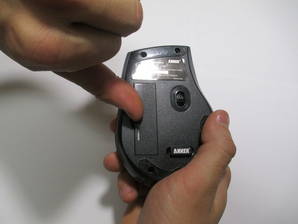 Use a finger nail or flat head screwdriver to remove the battery cover.