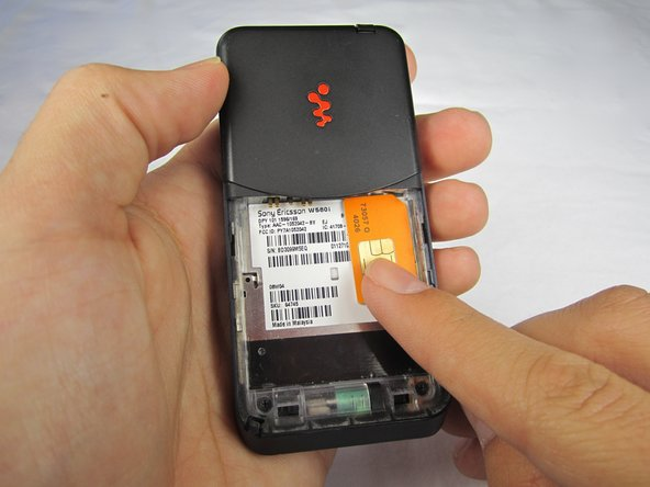 Slide the SIM card down out of the slot.