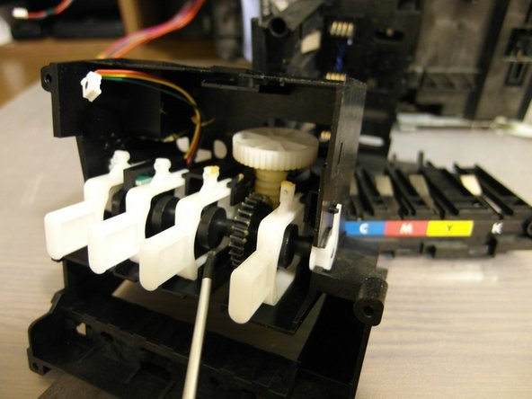 This is the ink cartridge pumping mechanism. The last DC motor we detached controls this mechanism.