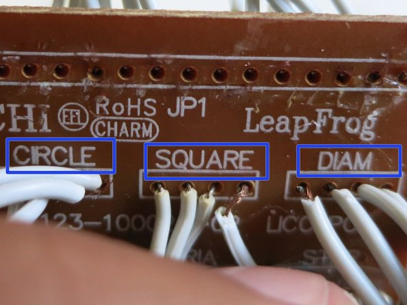 Image 3/3: Each button has a group of four wires, and the circuit board is labeled with each of the buttons' names(i.e. circle, square, diamond, etc.). You can also follow the wires that are still connected as guidance.