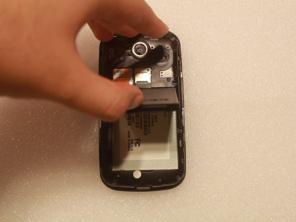Using your fingernail, gently pull the battery up and away from the rest of the device.