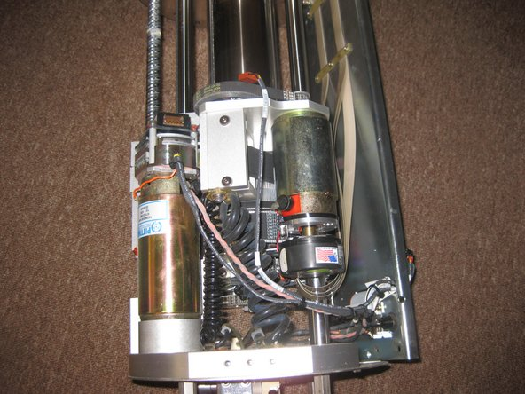 Image 3/3: This motor (2nd image) rotates the second arm linkage.