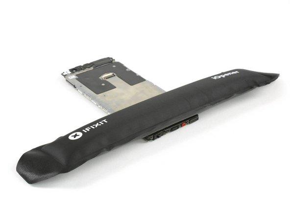 Use an iOpener to loosen the adhesive beneath the headphone jack.