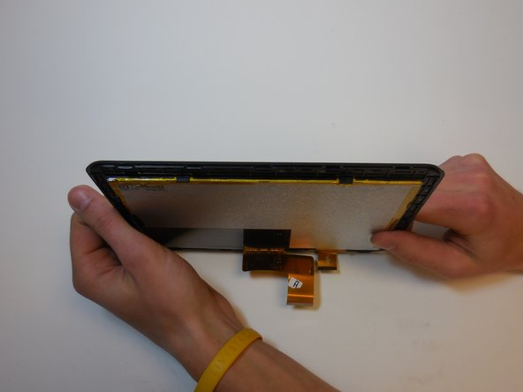 Image 1/2: Gently bend the matrix away from the screen to release the pressure clamps.