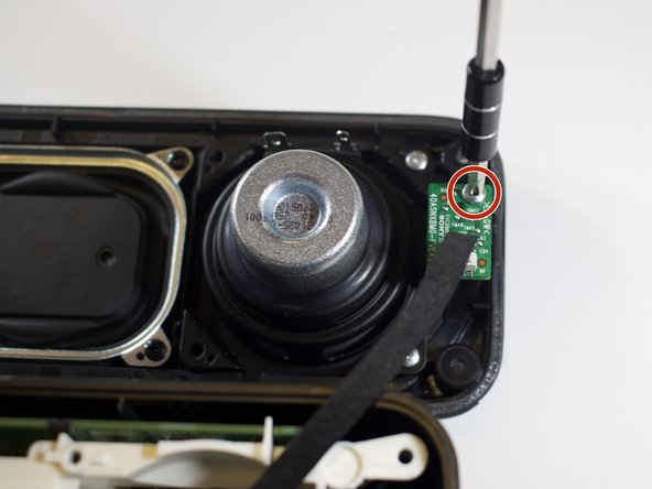 Locate the two silver screws (9 mm) attached to the two LED-light-chips on the speaker lid.