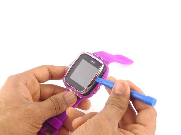 Use a plastic opening tool to gently pry the edges of the faceplate away from the watch.