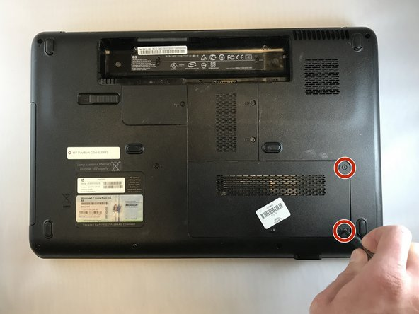 Remove the two 5.5 mm JIS#0 screws from the hard drive cover.