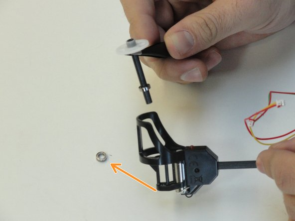 Once the ball-bearing is removed, use tweezers and remove the entire tube and gear from the drone arm assembly.