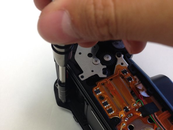 Using the J0 screwdriver, remove the 6.3 mm screw.