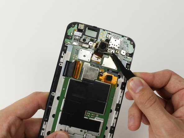 Image 2/2: Use tweezers to gently remove the rear facing camera.