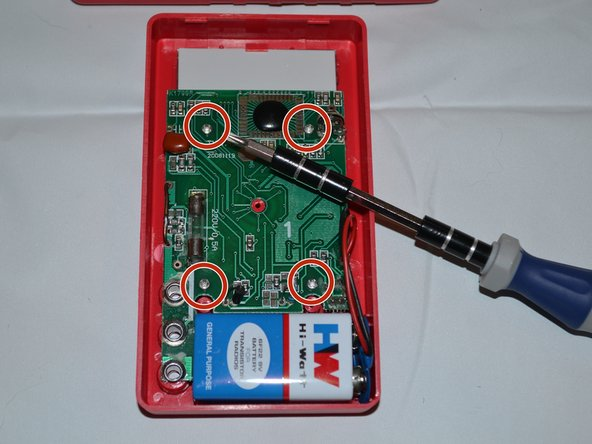 Remove the four 7mm Phillips screws holding the circuit board in place.