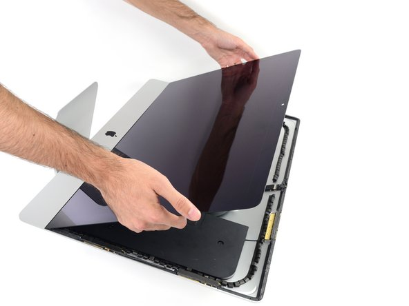 Image 1/3: Lift the display up from the frame and remove it from the iMac.