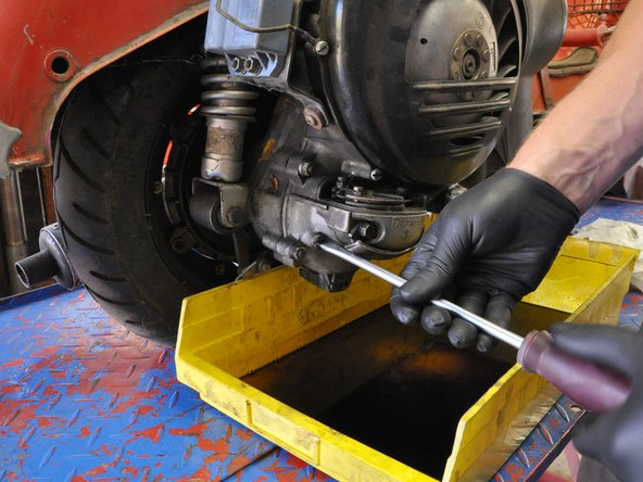 Using your hands, insert and hand-tighten the oil fill plug.