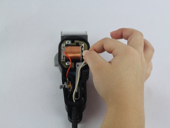 Remove the wires connected to the motor by firmly grasping both sides of a wire and wiggling until it is released.