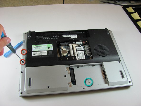 Image 1/1: Remove the one 5.0mm screw in the hard drive compartment.