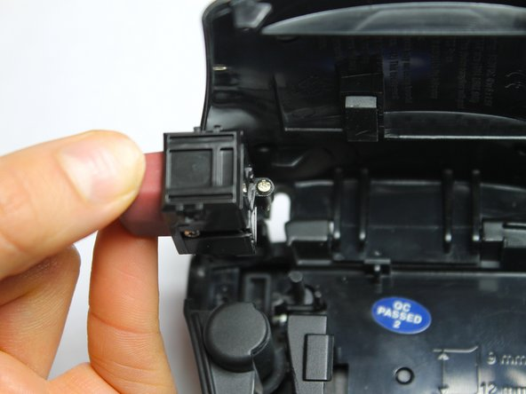 Image 2/3: Use Phillips #00 screwdriver to remove remaining two screws from the battery compartment