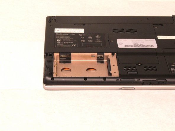 Finally, slide the hard drive out of its dock; then just lift the hard drive out of the pocket.