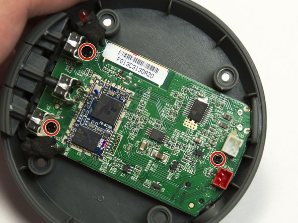 Remove the three black 6mm screws from the main board using a Philips #00 screwdriver.