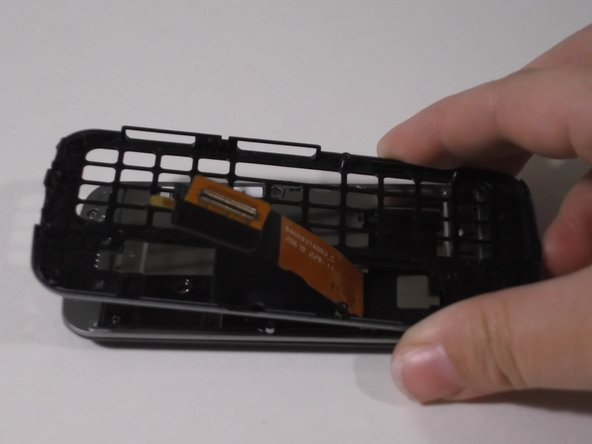 Separate the two parts of the phone by holding one side in each hand and pulling them apart. Set the part that held the slide-out keyboard aside.
