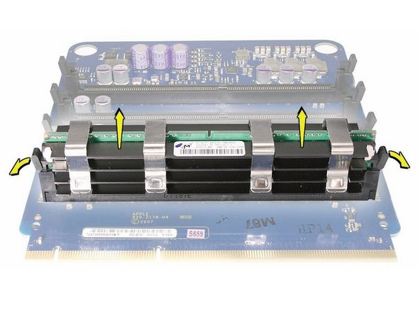 Open the ejectors on the DIMM slot by pushing them out to the sides, and remove the DIMM from the riser card.