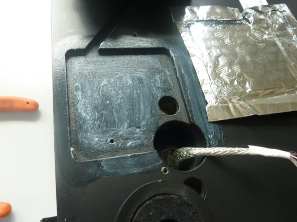 Image 1/1: Use some glue to fix the aluminum to the wood. '''Important:'''  Protect the  part where the printed circuit board might touch it and cause a short circuit. I have done it with insulating tape.