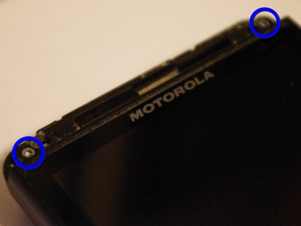 Now with both of the plastic covers removed, remove the 4 silver T5 screws on the top and bottom of the unit as shown.