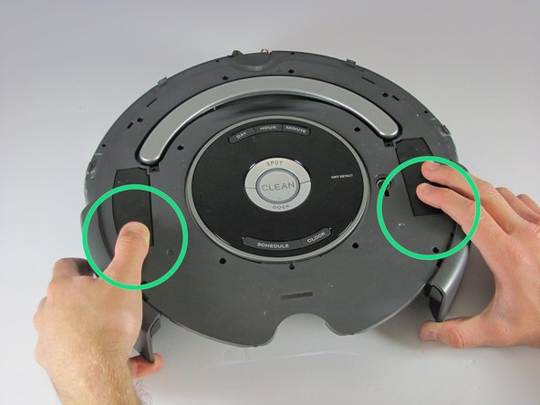Image 2/3: Use your Phillips head #2 to remove the two - 8mm screws by the handle