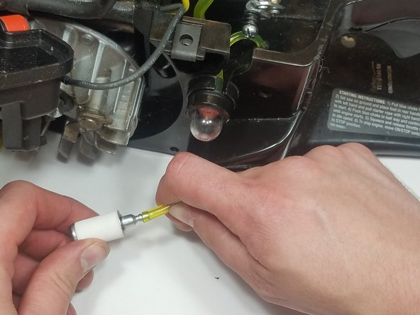 Push the fuel filter line  into the gas tank