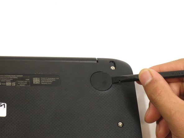 Pry off the rubber pads to reveal a screw under each pad.