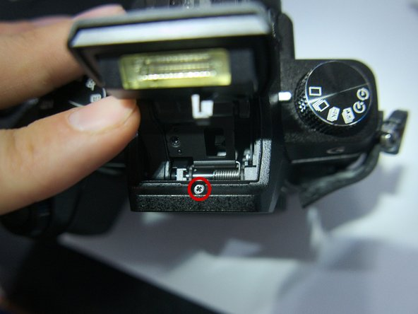Photo 2: Now hold the flash back to access a screw within the flash housing.