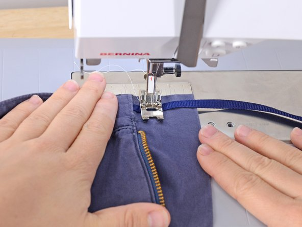 Sew the ribbon in place.