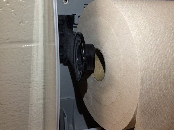 Image 2/3: Push holsters outwards when attempting to put a new roll in.